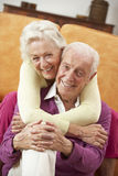 Romantic Senior Couple Relaxing At Home Stock Images