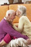 Romantic Senior Couple Relaxing At Home Stock Photo