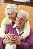 Romantic Senior Couple Relaxing At Home Stock Photos