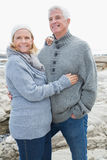 Romantic senior couple on a rocky beach Royalty Free Stock Image