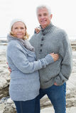 Romantic senior couple on rocky beach Royalty Free Stock Photos