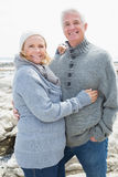 Romantic senior couple on rocky beach Royalty Free Stock Image