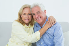 Romantic senior couple sitting at home Stock Photo