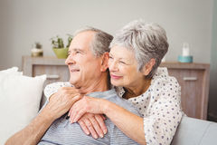 Romantic senior couple sitting in living room. At home royalty free stock image