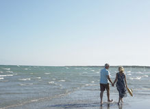 Romantic Senior Couple Walking On Beach Royalty Free Stock Photography