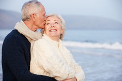 Romantic Senior Couple On Winter Beach royalty free stock photo