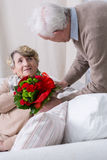 Romantic senior husband Stock Image