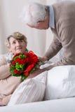 Romantic senior husband Stock Image