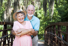 Romantic Seniors on Bridge. Portrait of a romantic senior couple on a bridge with Spanish Moss hanging overhead Royalty Free Stock Photos