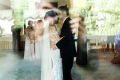 Romantic and sensual couple beautiful bride and groom dancing re Royalty Free Stock Photography
