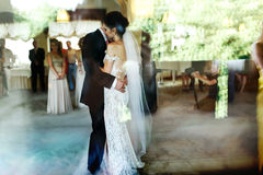 Romantic and sensual couple beautiful bride and groom dancing re Stock Images