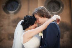Romantic sensual husband and wife hugging in front of old church Stock Images