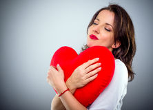 Romantic sentimental woman with a heart Stock Photos