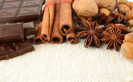Romantic set of chocolate,anise,nuts and cinnamon on white flax Stock Photo