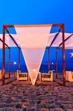 Romantic set up dinner on the beach, twilight time Stock Photo