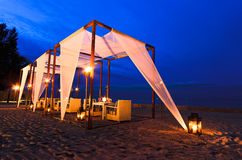Romantic set up dinner on the beach, twilight time Stock Image