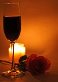 Romantic setting. Items: a rose, candles and wine Stock Photography