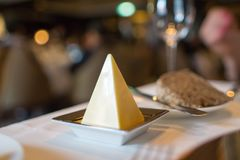 Romantic setup appetizer with butter stick pyramid and bread. Romantic setup appetizer with butter stick pyramid  and bread Stock Images