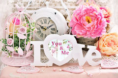 Romantic shabby chic love decoration. Romantic love decoration in shabby chic style with letters,flowers,vintage clock and bird cages Royalty Free Stock Photos