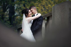 Romantic shot of newlywed husband and wife hugging on old stairc Royalty Free Stock Photo
