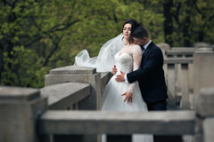 Romantic shot of newlywed husband and wife hugging on old stairc Stock Photo