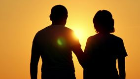 Romantic silhouette of a young couple