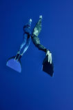 The romantic simultaneous freedive into the depth. Two freedivers - the man and the woman - are making the simultaneous dive at the depth of Blue Hole, Red Sea Stock Image