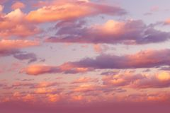 Romantic sky. Background, beautiful fluffy pink clouds, amazing view on the dramatic sunset sky, natural textured wallpaper, vanilla sky stock photos