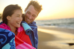 Romantic smiling mixed race couple on beach sunset Stock Images