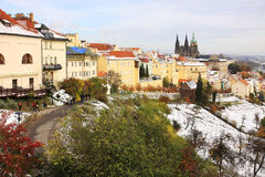 Romantic snowy colorful autumn Prague gothic Castle, Czech Republic Stock Image