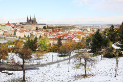 Romantic snowy colorful autumn Prague with gothic Castle Royalty Free Stock Photos