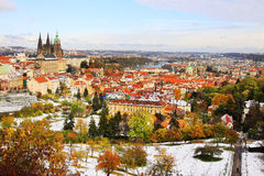 Romantic snowy colorful autumn Prague gothic Castle with St. Nicholas' Cathedral Stock Photo