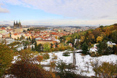 Romantic snowy colorful autumn Prague with gothic Castle and St. Nicholas' Cathedral, Czech Republic Stock Image