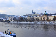 Romantic snowy Prague gothic Castle abova River Vltava, Czech Republic Royalty Free Stock Images