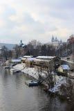 Romantic snowy Prague gothic Castle abova River Vltava, Czech Republic Stock Photos