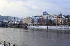 Romantic snowy Prague gothic Castle abova River Vltava, Czech Republic Stock Images