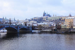 Romantic snowy Prague gothic Castle abova River Vltava, Czech Republic Royalty Free Stock Photography