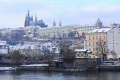 Romantic snowy Prague gothic Castle abova River Vltava, Czech Republic Royalty Free Stock Photos