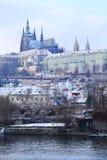 Romantic snowy Prague gothic Castle abova River Vltava, Czech Republic Stock Photography