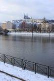 Romantic snowy Prague gothic Castle abova River Vltava, Czech Republic Stock Image