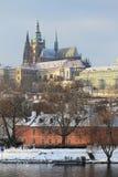 Romantic snowy Prague gothic Castle abova River Vltava, Czech Republic Royalty Free Stock Photo