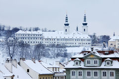 Romantic snowy Prague Roofs with Strahov Monastery Royalty Free Stock Images