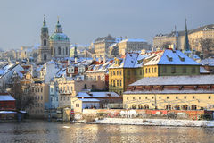 Romantic snowy Prague St. Nicholas' Cathedral, Czech Republic Stock Photo