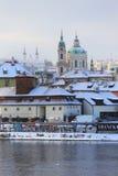 Romantic snowy Prague St. Nicholas' Cathedral, Czech Republic Stock Images