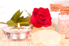 Romantic spa with rose and candle close up. Romantic spa concept with rose, bath salts  and candle close up Royalty Free Stock Images