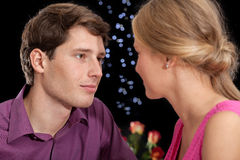 Romantic stares. A close up of a clouple exchanging romantic stares Royalty Free Stock Images