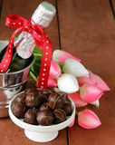 Romantic still life champagne, flowers tulips Stock Photos