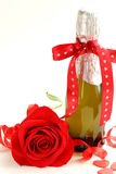Romantic still life champagne, roses, gifts Stock Image