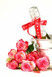 Romantic still life champagne, roses, gifts Royalty Free Stock Photography