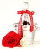 Romantic still life champagne, roses, gifts Stock Photography